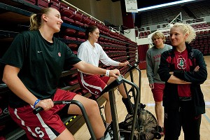 Borchardt, right, checks on Mikaela Ruef, left, and Sarah Boothe on the stationary bikes.