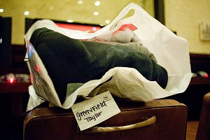 A bag of clean clothes awaits freshman Taylor Greenfield in the lobby of the Sheraton Hotel near campus, where the women's and men's basketball teams and the football team stay in the week after final exams, when dorms are closed.