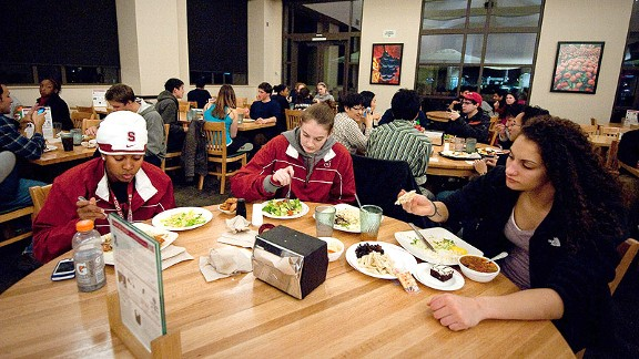 Jasmine Camp, Bonnie Samuelson and Erica Payne chow down in the new dining hall, which is shared by regular students.