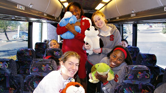 Pillow Pets make great traveling companions. Toni Kokenis (tiger), Nneka Ogwumike (bunny), Lindy La Rocque (panda) and Chiney Ogwumike (turtle) show off theirs.