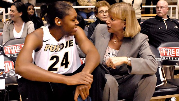 Drey Mingo chats with Purdue coach Sharon Versyp after returning from a near-fatal bout of bacterial meningitis last season that left her severely hearing impaired.