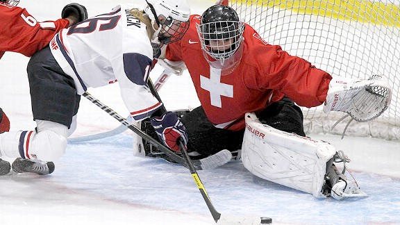 Goaltender Florence Schelling led improving Switzerland to the bronze medal at the world championships, its first-ever medal in women's hockey.