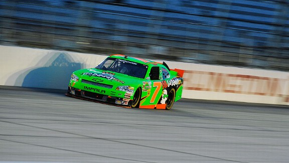 Danica Patrick managed to avoid trouble on the famous backstretch wall Friday night.