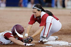 Oklahoma's Javen Henson, right, tags out Alabama's Jazlyn Lunceford on a play at third base.
