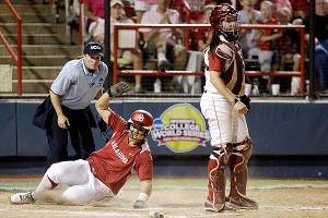 Oklahoma's Keilani Ricketts slides home safely on a sixth-inning squeeze play Monday.