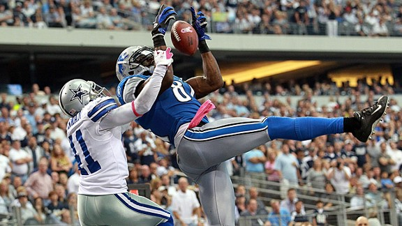 Calvin Johnson catches a touchdown pass against the Cowboys' Terence Newman on Oct. 2, 2011.