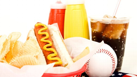 Ballpark food can be filled with calories. A hot dog and chips may mean a trip to the gym.