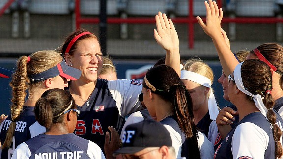 Pitcher Keilani Ricketts accepts high-fives from her teammates after leading the U.S. in the 2012 World Cup of Softball.