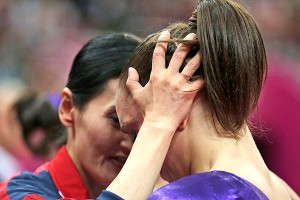 Jordyn Wieber is consoled by U.S. coach Jenny Zhang following her elimination from the all-around competition, despite having the fourth-best performance among all gymnasts.