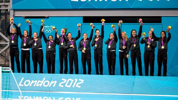 Annika Dries, third from the right, and the rest of her team celebrate the first Olympic gold medal for U.S. women's water polo.
