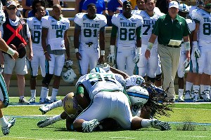 Tulane safety Devon Walker suffered a broken neck in a head-to-head collision with a teammate Saturday. Doctors will need to operate and said the possibility of paralysis was still unknown.