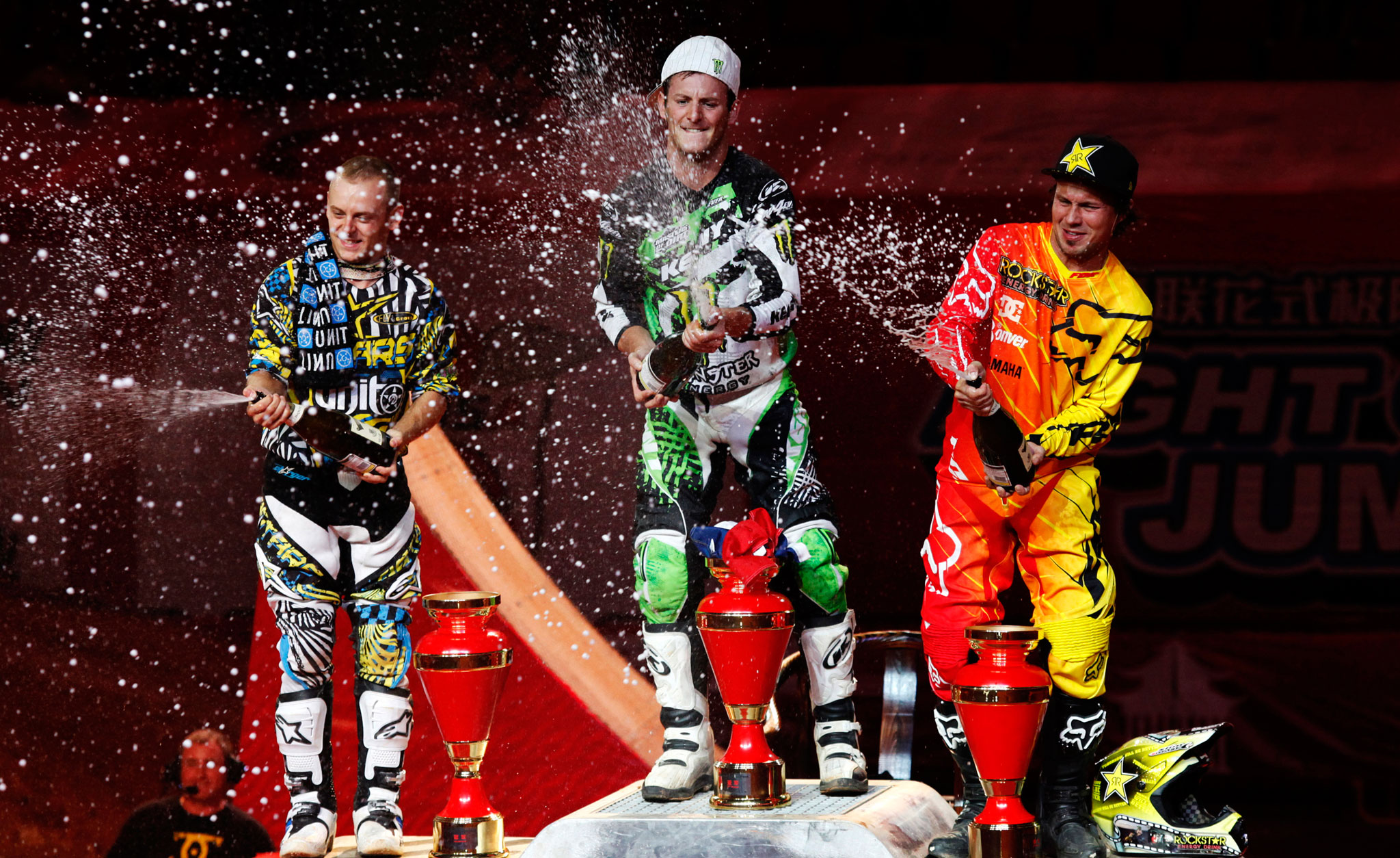 Rmi Bizouard celebrates with Maikel Melero, left, and Libor Podmor, right, after winning Round 8 of the 2012 FIM World Championship series on Saturday in Guangzhou, China.