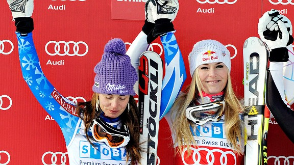 Lindsey Vonn, right, celebrates her super-G win from Saturday's World Cup race with second-place finisher Tina Maze. Maze's camp accused Vonn of unsportsmanlike conduct.