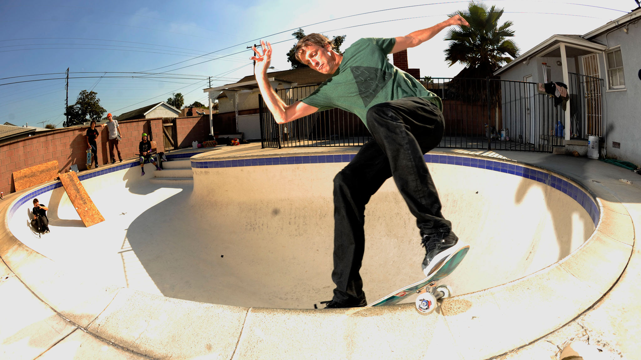 Tony Hawk smith grinds his Indy's in a backyard pool -- can't get much more classic than that.