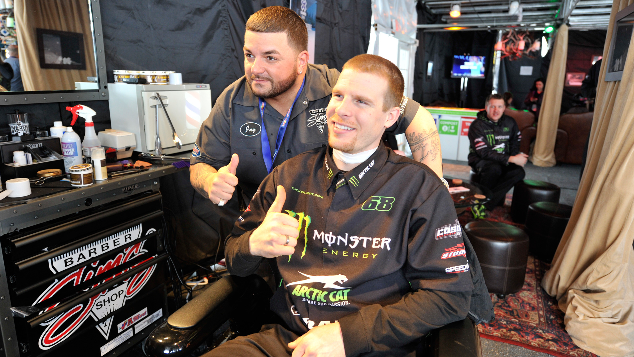 Jason Raposo (L) gave SnoCross rider Tucker Hibbert (R) some clean lines at Uncle Jack's Parlor at X Games Aspen 2013.