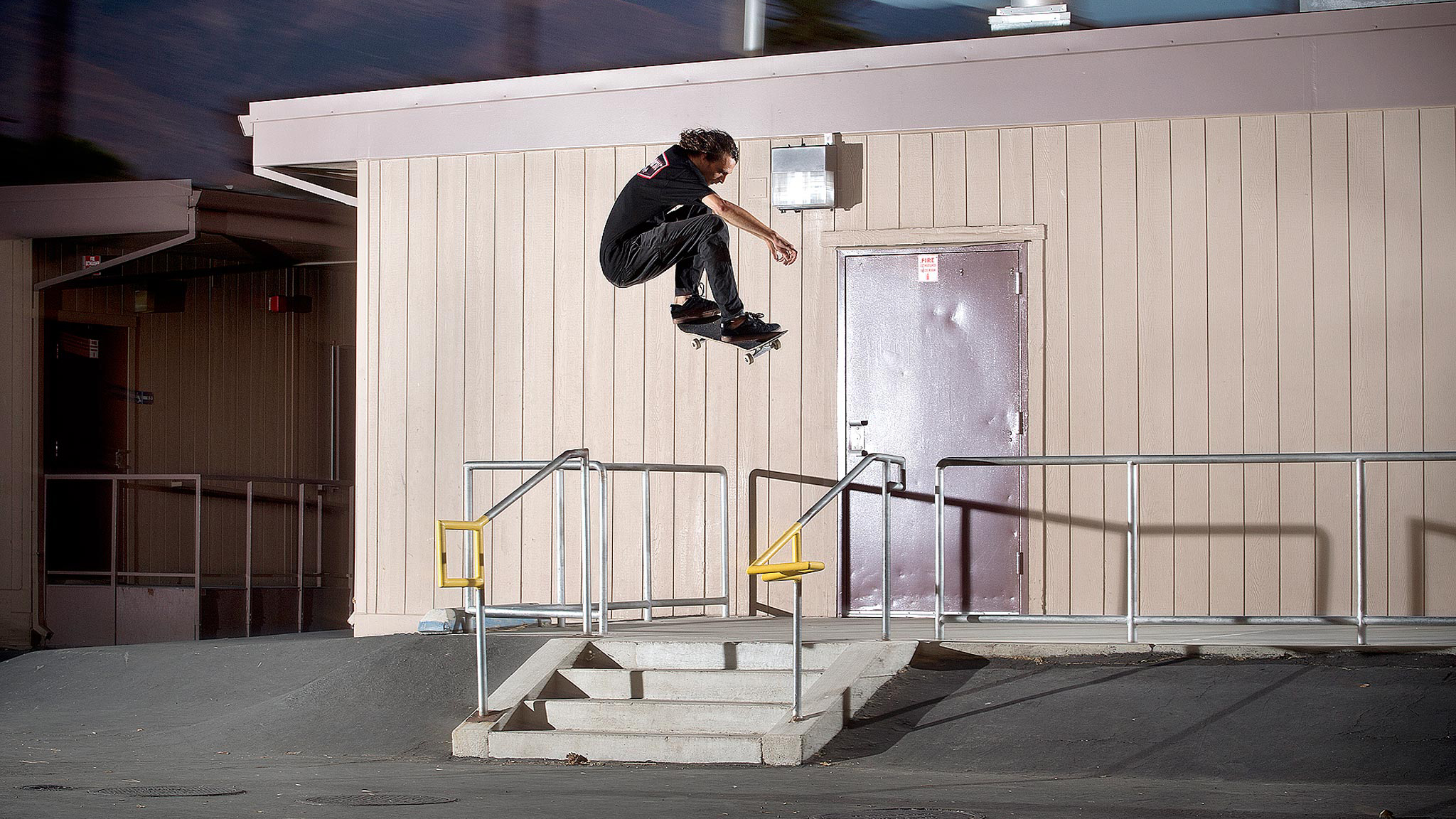 Evan Smith ollies over stairs and rails at an epic spot.