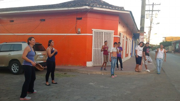 Jessica, left, and Ruby take part in an impromptu pick-up game of catch with the locals.