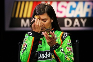 Danica Patrick freshens up her makeup before meeting with the media Thursday at Daytona.