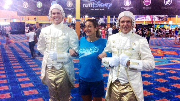 Summer Sanders, flanked by princes, thoroughly enjoyed her race weekend at runDisney.
