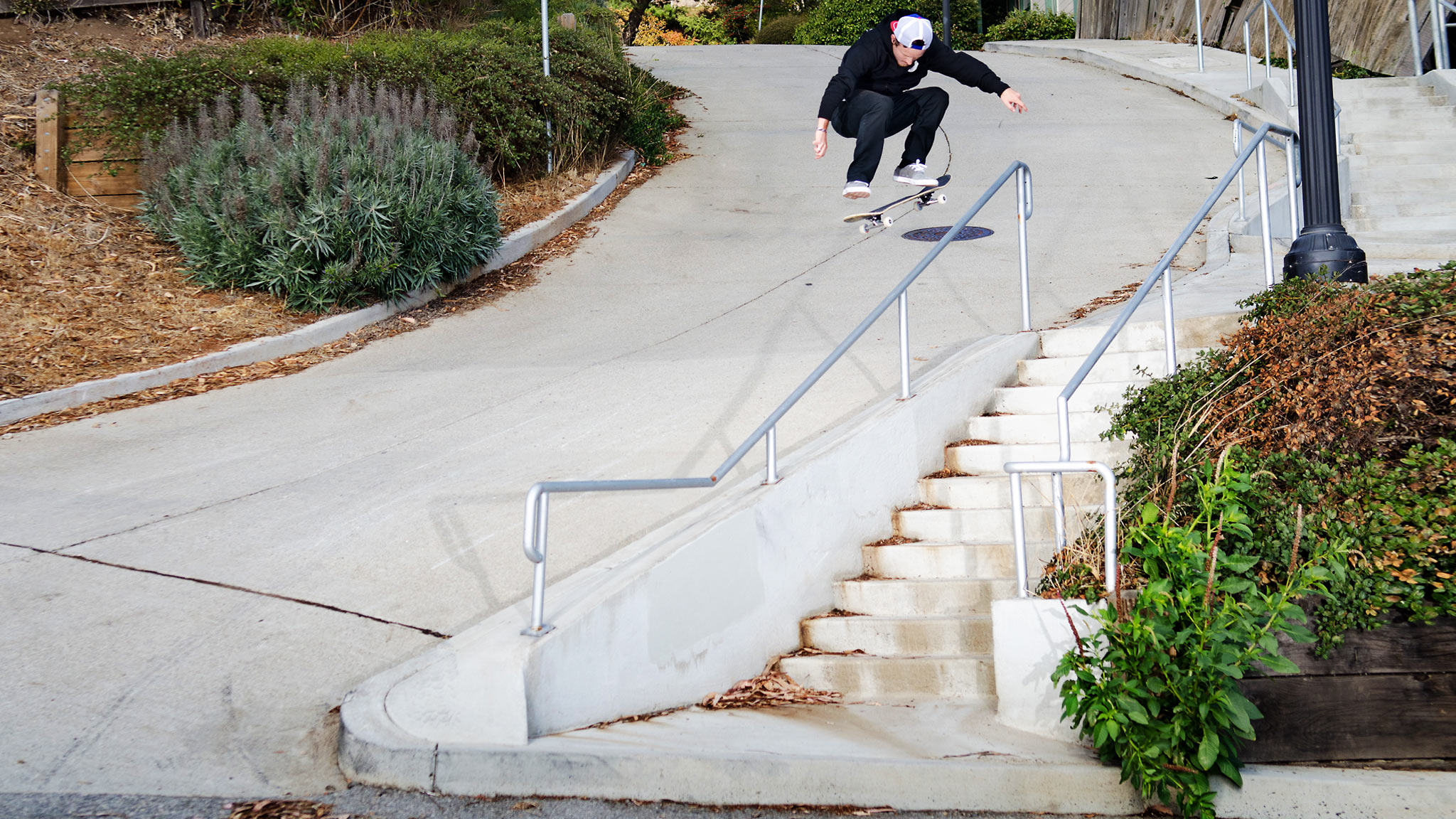 Cody Catfish McEntire switch kickflips a rail into the streets of San Francisco.