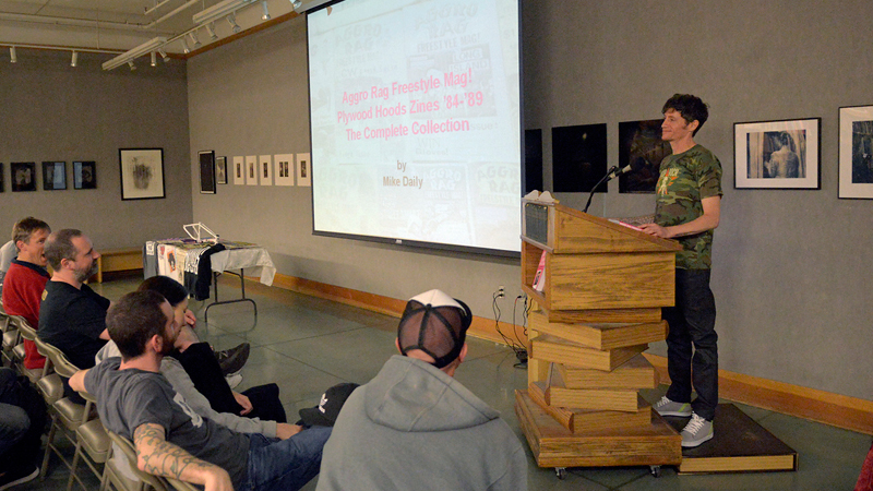 Aggro Rag creator Mike Daily speaking at Powells City of Books in Portland, Ore.