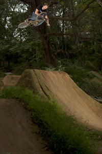He doesn't just build the course, he also rides them. Dave King, switch table at the Posh trails in 2009.