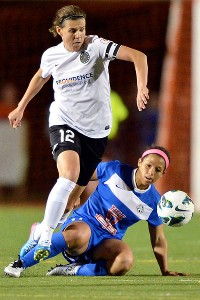 Portland forward Christine Sinclair (12) leaves Kansas City midfielder Desiree Scott behind during second-half play.