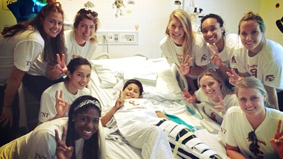 It was hard to tell who had the bigger smiles, Emily Young and her teammates or the young patients they visited.
