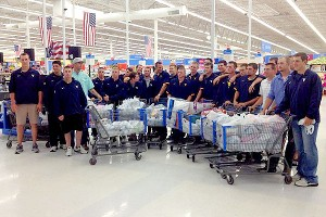 When tornadoes hit near its hotel, the West Virginia baseball team shopped for supplies to help those in need.