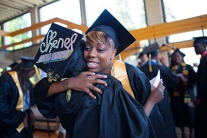 Tierra Rogers, receiving a hug, was the first person in her family to graduate from college.