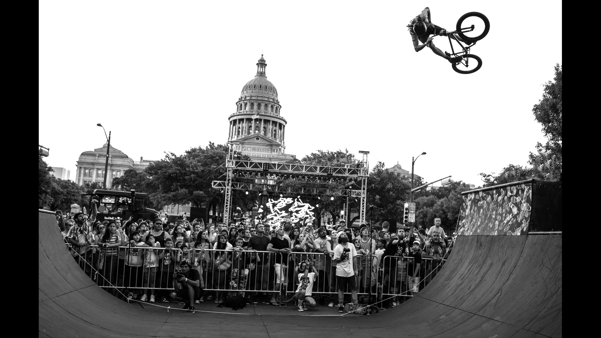 X Games BMX Park competitor Tom Dugan airs near the State Capitol building in Austin, Texas at an X Games rally in June.