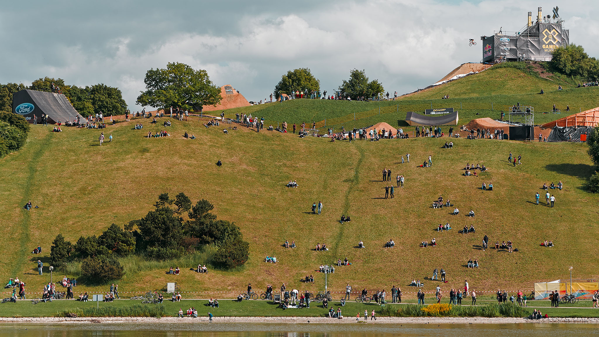 pSpectators hang in the sun on the Olympic Hill at X Games Munich on Friday as the world's best mountain bikers practice for the first-ever Mountain Bike Slopestyle contest in X Games' history./p