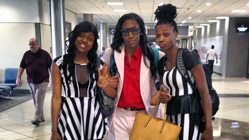 Kelsey Bone, center, and fellow Liberty rookies Toni Young, right, and Kamiko Williams, left, donned tacky outfits on their first road trip to Atlanta.