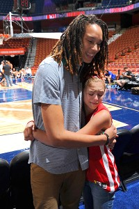 Griner poses with young fan at All-Star weekend.