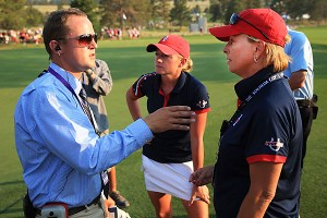 Dottie Pepper, right, and U.S. player Stacy Lewis discussed a crucial ruling with officials at last weekend's Solheim Cup. After 27 minutes, a European player was allowed to hit from an incorrect spot.