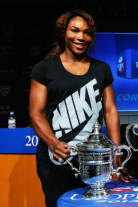 Serena Williams smiles alongside the women's US Open trophy during the draw ceremony. The No. 1 seed is favored to maintain her title.