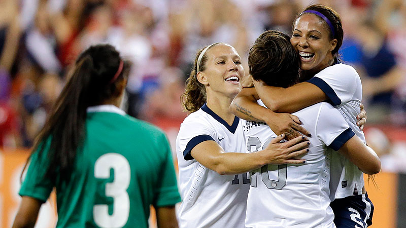 Lauren Holiday joins the celebration as Abby Wambach (20) hoists Sydney Leroux after Leroux's first goal in Tuesday's soccer friendly against Mexico.
