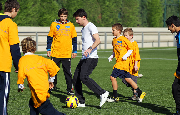 Lionel Messi meets a group of children suffering from serious illnesses. Chris Hegardt is pictured immediately behind Messi on the right.