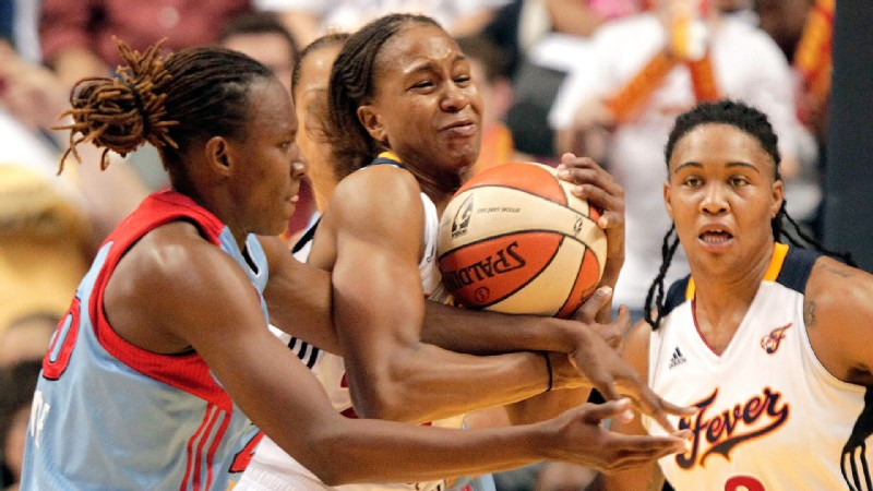 Tamika Catchings, center, battles Atlanta's Sancho Lyttle for the ball. The Fever and Dream will meet in the WNBA playoffs for the third straight year.