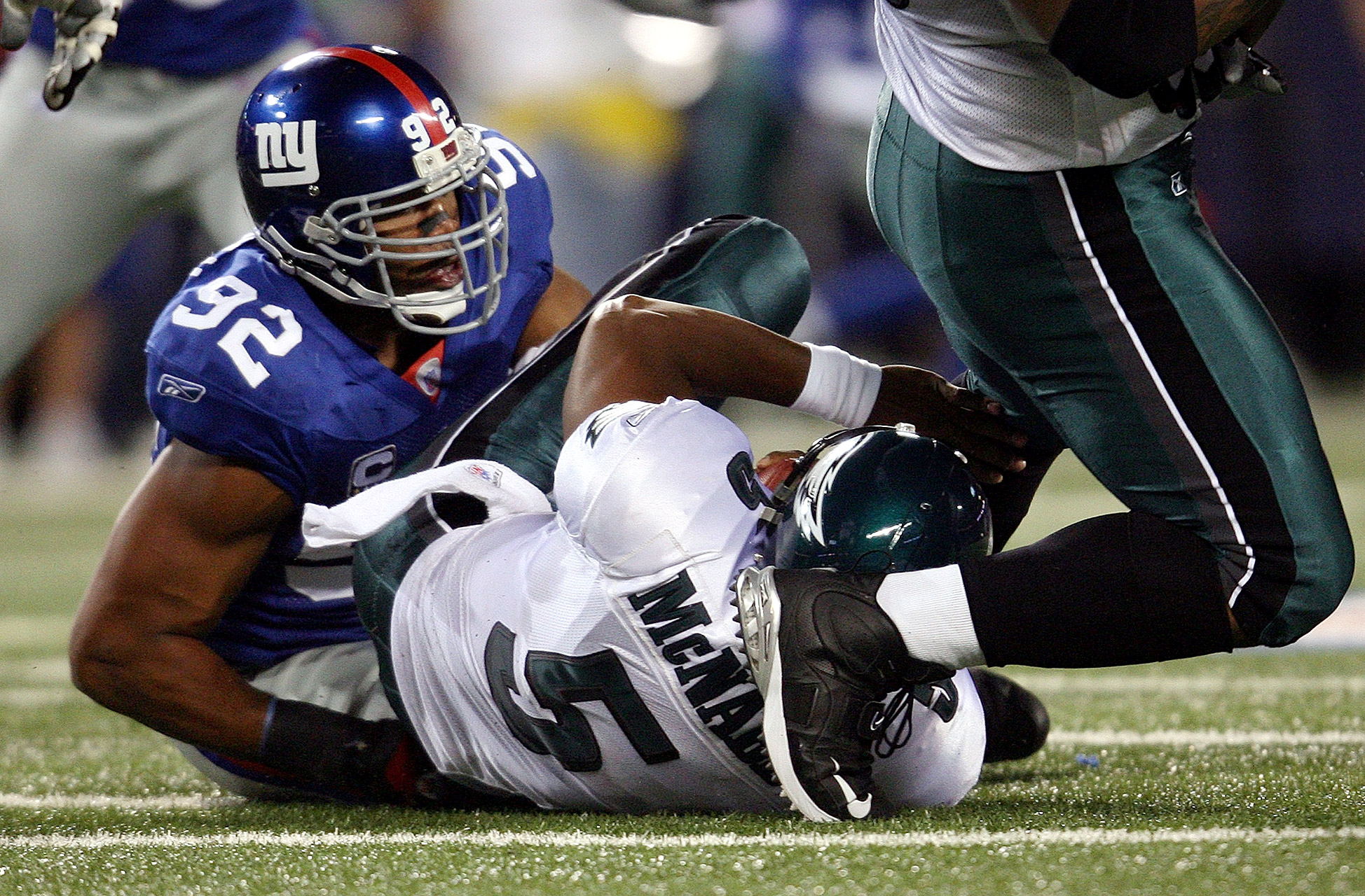Michael Strahan became the Giants' all-time sack leader when he brought down Donovan McNabb on Sept. 30, 2007. The two later appeared in a Dr Pepper commercial together.