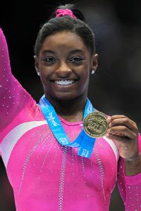 Simone Biles edged U.S. teammate Kyla Ross by less than a point to win the women's all-around title at last week's world championships.