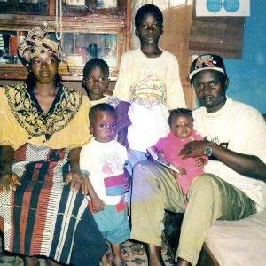 As an infant in Sierra Leone, before she lost her right arm, Memuna was photographed with her parents and three older brothers.