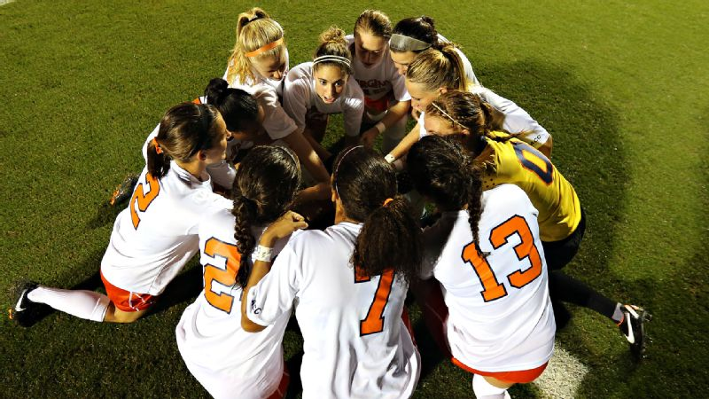Morgan Brian leads the Virginia soccer team in a huddle. The Cavaliers will play without her this weekend when they play North Carolina because of Brian's duties with the U.S. national team.