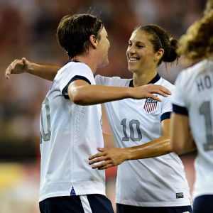 Carli Lloyd (right) celebrates with teammate Abby Wambach. Lloyd and the USWNT play New Zealand in two games next week.