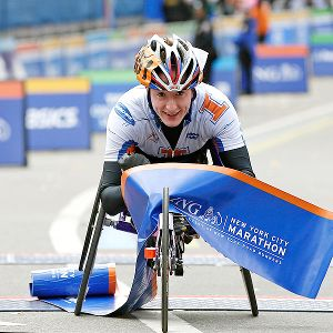 American Tatyana McFadden won the women's wheelchair race, becoming the first to win in London, Chicago, Boston and New York in the same year.