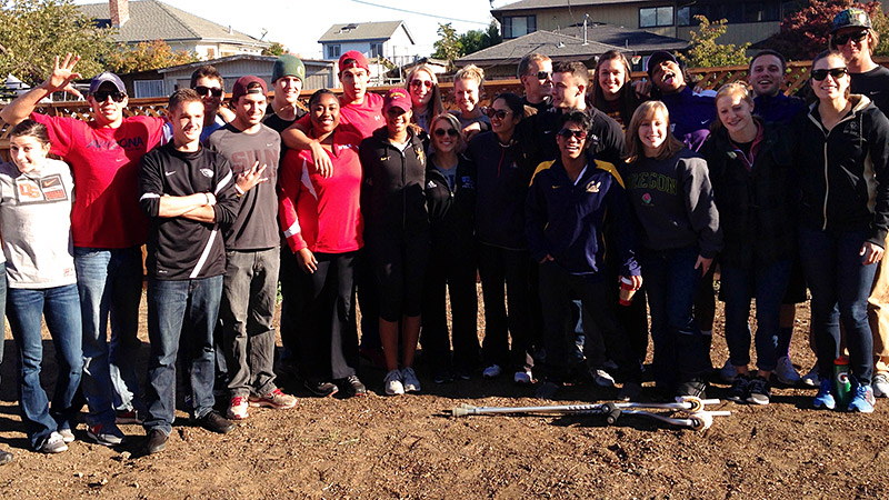 The Pac-12 student-athletes participated in a community service project at the Redwood Family House, installing an irrigation system and planting grass for a playground.
