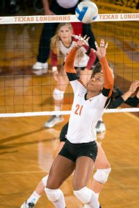 Part of a setters job is to read the court; Chloe Collins is still learning.