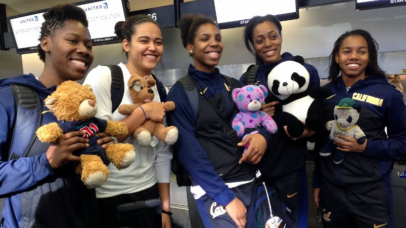 Left to right, Cal players Afure Jemerigbe, Justine Hartman, Reshanda Gray, Kyra Dunn and Brittany Shine pose with their stuffed Bears at the San Francisco airport before departing for Newark, N.J.