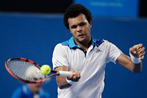 Jo-Wilfried Tsonga finished his win under a closed roof after the extreme heat policy went into effect.