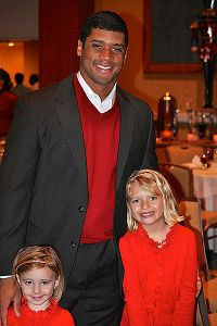 Russell Wilson, with the Hortons daughters, was invited by Maura Horton to speak to schoolchildren about bullying, which he admitted he had been guilty of.